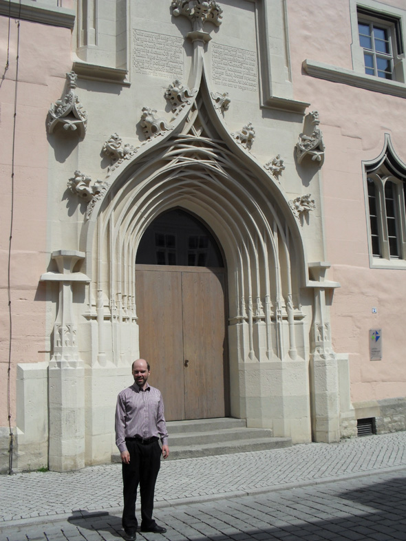 Rémi in front of the main building of the old University of Erfurt