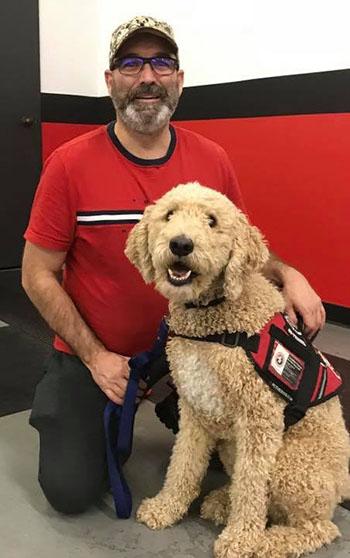 Le sergeant Richard Boutet, maintenant retraité, et son chien Max